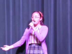 "Seventh Grader, Kristen Chua, performed ""Climb Every Mountain"" from the Sound of Music"
