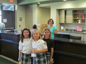 Some lovely 2nd graders enjoying the new library.