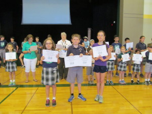 The winners from Grades K-5  (From left to right)  3rd Place: Jules Gaynor, Room 19, 7125 pages read!  2nd Place: Aidan Haines, Room 10, 7,445 pages read!  1st Place: Isabelle Love, Room 10, with an astounding 12,396 pages read!  Way to go, SUPERSTAR readers!!